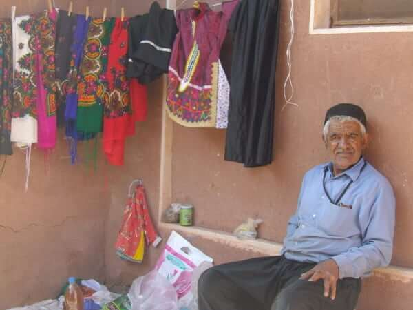 Resident of Abyaneh on the lookout for tourists